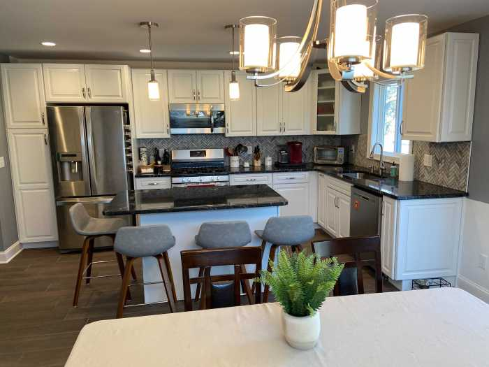 newly renovated kitchen with white cabinets